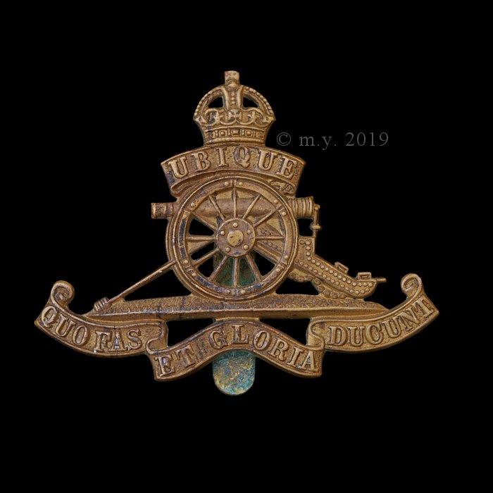 Royal Artillery other ranks beret badge.